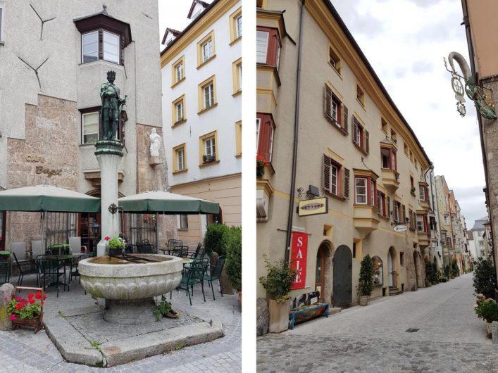 unterwegs in den Gassen von Hall in Tirol vorbei an Brunnen und alten Häusern mit Erkern und Zunftschildern