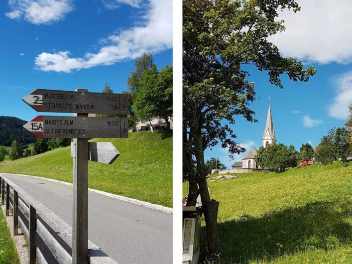 Wanderschilder in Hafling und Blick zurück auf die Dorfkirche
