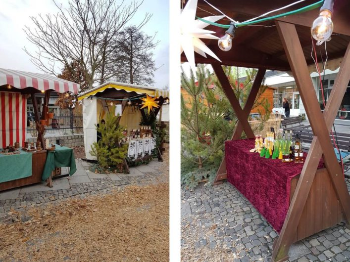 Buden auf dem Weihnachtsmarkt im Großen Spreewaldhafen in Lübbenau