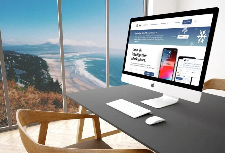Finanzplattform Iban Wallet auf Desktop und Blick aufs Meer